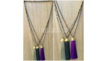long seed crystal multi tassel necklace golden chrome
