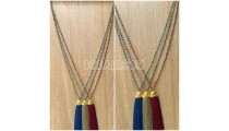 long seed crystal tassel necklace golden chrome